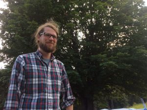 Andrew, North Clackamas Urban Watershed Council Coordinator, smiles on the perfect picnic and community collaboration.