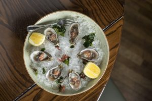 Oysters on the Half Shell, seasonal mignonette, half-dozen Raven & Rose and The Rookery Bar, in downtown Portland, Oregon.